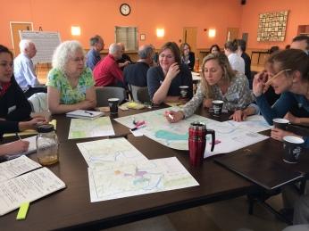 Using maps on table for better understanding.