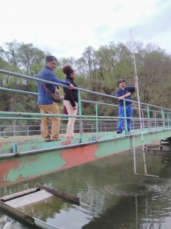 Checking the water at second clarifying pond